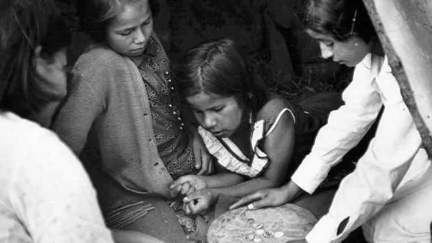 The game Waltes, which has variations once played by aboriginal people throughout North America, is believed to date from long before contact with Europeans. In this 1936 photo, Mi'kmaq children play Waltes.