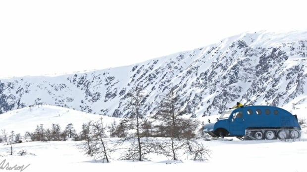 Joey Young and his grandfather Hemblah Young both drive their 1957 Bombardier snow machines throughout the Bonne Bay area.