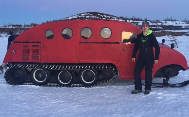 Joey Young with 1957 Bombardier snow machine