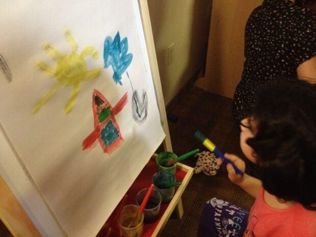 syrian refugees painting playgroup radisson hotel