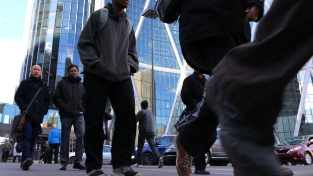 Alberta's population will continue to grow even in the face of the current economic downturn, an ATB Financial report suggests. (AFP/Getty Images)