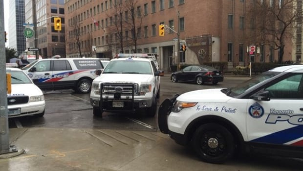 Toronto police vehicles converge on Church and Charles streets in search for woman wanted in stabbing a concierge in a Rosedale apartment building. Ellis Kirkland, 60, was later arrested and charged with attempted murder.