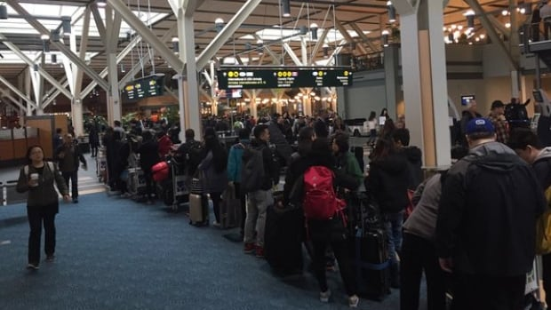 Line-ups at Vancouver International Airport Thursday were caused by an earlier computer issue.