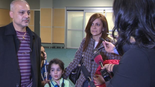 Syrian refugees Vicken Majarian, Alin Arekelian and their children speak to CBC reporter Bal Brach after arriving at YVR.
