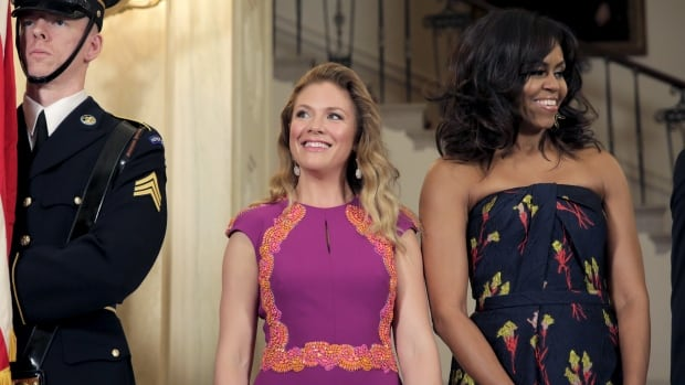 Sophie Gregoire-Trudeau wore a gown by Toronto designer Lucian Matis to the White House state dinner for her husband Thursday night. Her new 'soulmate' Michelle Obama also went Canadian chic in a dress by Jason Wu.