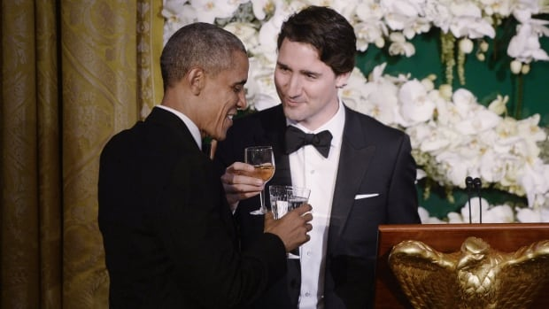 U.S. President Barack Obama and Prime Minister Justin Trudeau exchange toasts during a state dinner at the White House on Thursday.