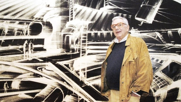 German production designer Ken Adam, seen in front of one of his futuristic set drawings on display in Berlin in 2002, has died at the age of 95.
