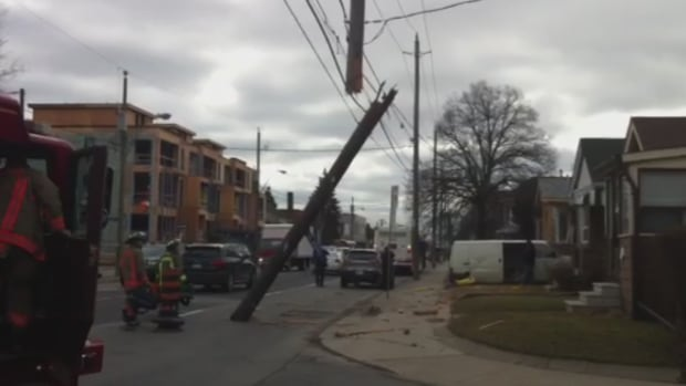 Hydro pole snapped in two by TTC bus at Jane Street, north of Bloor Street.