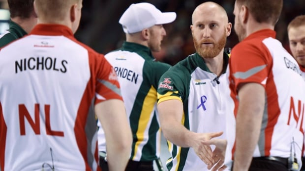 Northern Ontario skip Brad Jacobs shakes hands with Newfoundland and Labrador skip Brad Gushue following his win to move to a perfect 11-0 after round-robin play.