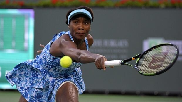 Venus Williams returns a volley from Kurumi Nara during their match at the BNP Paribas Open tennis tournament on Friday in Indian Wells, Calif.