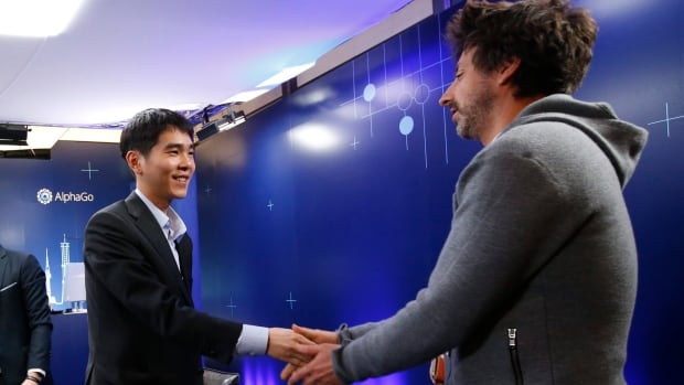 South Korean professional Go player Lee Sedol, left, shakes hands with Google co-founder Sergey Brin, right, after winning the fourth match of the Google DeepMind Challenge Match against the company`s artificial intelligence program, AlphaGo, in Seoul, South Korea, Sunday.