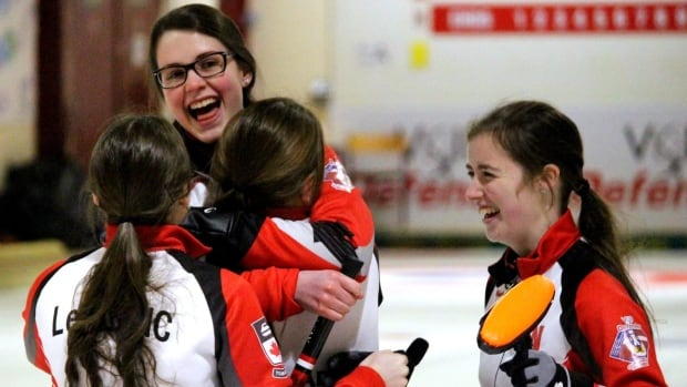 Team Canada's Mary Fay, Kristin Clarke, Karlee Burgess, and Janique LeBlanc celebrate victory in Denmark at the women's final at world junior curling championship.