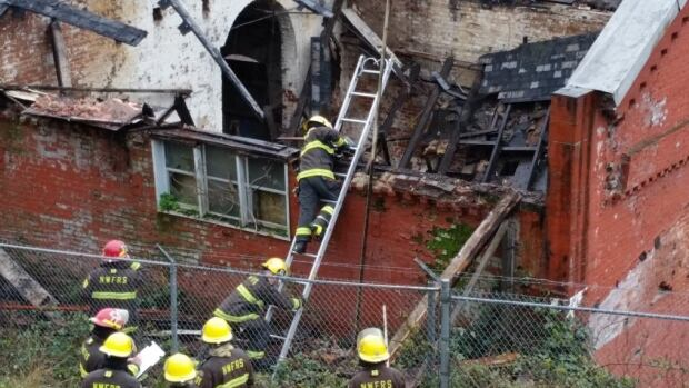 This photo from @NewWestGuests on Twitter shows firefighters assessing the collapsed roof of the 1886 Gas Works building.