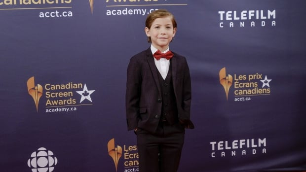 Jacob Tremblay, winner of the best actor award for Room, walks the red carpet before the Canadian Screen Awards in Toronto on Sunday.