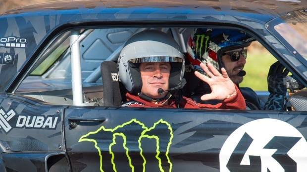Actor and Top Gear presenter Matt LeBlanc, left, waves as he sits with rally driver Ken Block during filming of BBC Top Gear in Westminster, London on Sunday.