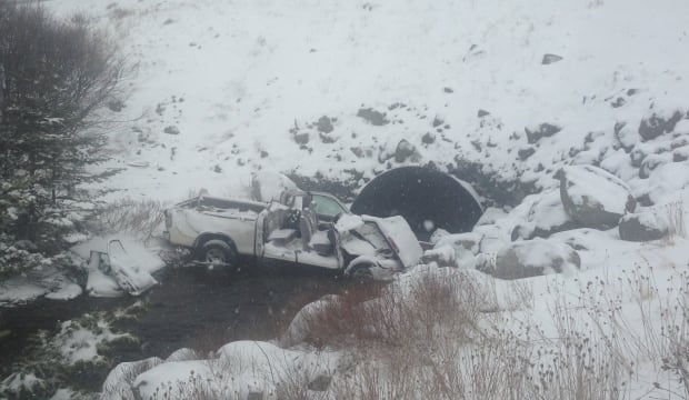 Pickup truck over embankment in Holyrood