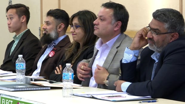 Green Party candidate Thana Boonlert, Liberal Khalil Karbani, NDP Roop Rai, PC Prab Gill, and Devinder Toor of the Wildrose attend a debate on Sunday.