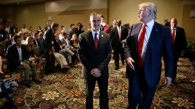 Republican presidential candidate Donald Trump, right, walks with his campaign manager Corey Lewandowski after speaking at a news conference in Dubuque, Iowa in August 2015.  Breitbart News reporter Michelle Fields, who said that she was grabbed by Lewandowski as she attempted to question Trump in Florida on March 8, 2016.