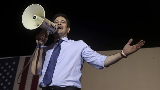 U.S. Senator and Republican presidential candidate Marco Rubio speaks from the bed of a pick up truck at a campaign rally in Miami Monday night.