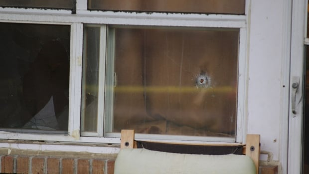 A bullet hole left in the front window of a home on Paulander Drive in Kitchener.