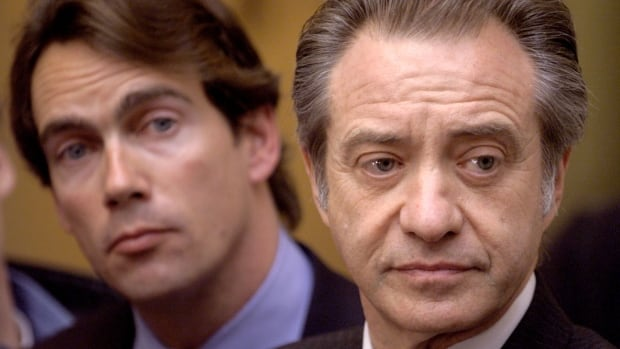 Postmedia boss Paul Godfrey, right, in 1998 when he was president of Sun Media, with then Quebecor vice-president Pierre Karl Peladeau during a series of mergers and takeovers that resulted in consolidation in Canada's newspaper sector.