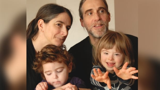 Anouk Lanouette-Turgeon and Roberto Murray's two-year-old daughter Lhassa, bottom left, has a neurological disorder and requires round-the-clock care. Their son Éli, 5, has Down syndrome.