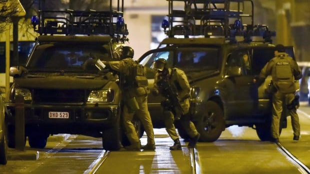 Belgian police launched an anti-terror raid linked to last year's Paris attacks in a Brussels neighbourhood on March 15, 2016.
