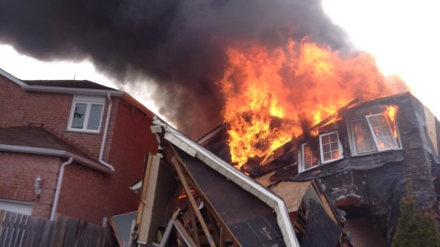 Six people were hospitalized after a massive fire tore through a Markham home on Tuesday afternoon.