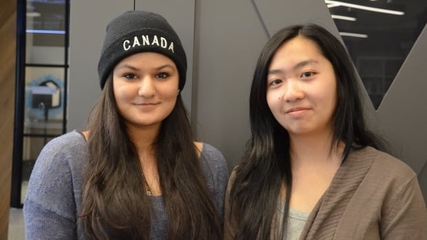 Hina Mir, left, and Julia Phan, have been with Girls Crack the Code since the early days. Both are from Toronto's Regent Park neighbourhood and say building supportive networks among young women of colour will be key to closing the gender gap in tech and making the industry more diverse.