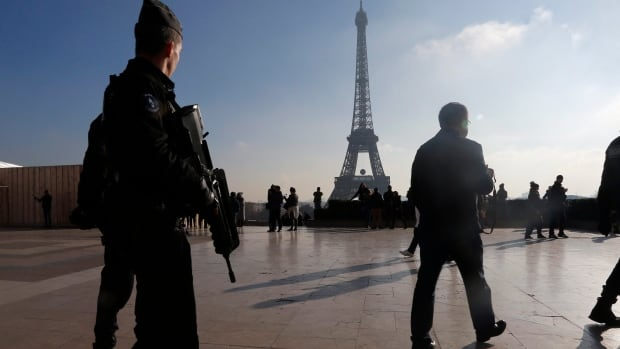 French police officers patrol near the Eiffel Tower, in Paris in Nov. 2015. Police said four who were planning an attack have been arrested, according to a media report.