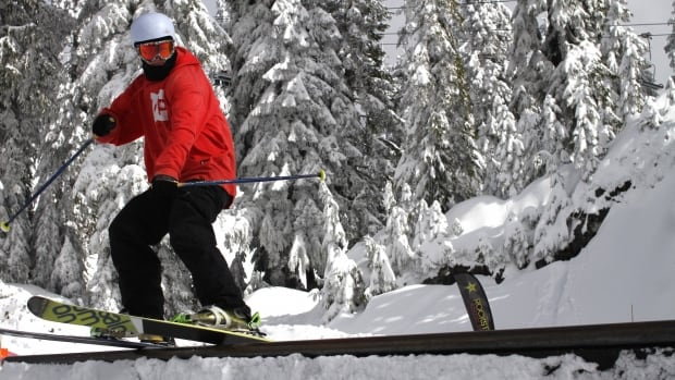 """North Vancouver's Liam Ponton slides a rail at Mount Seymour on Wednesday """"Who could work on a day like this?"""" he asked."""
