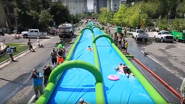 A giant slip-and-slide is coming back to the city to cool down Torontonians this summer.
