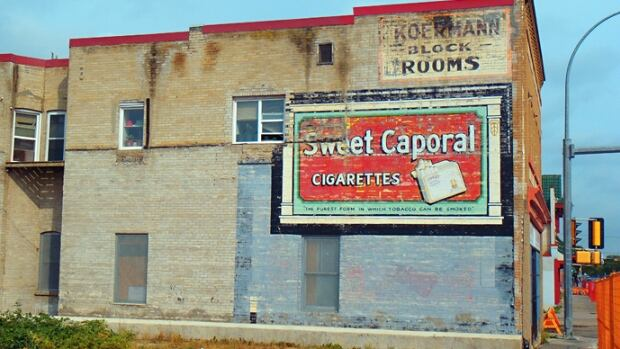 "New development in the Quarters has put this ""Sweet Caporal"" cigarette ad at risk of demolition."