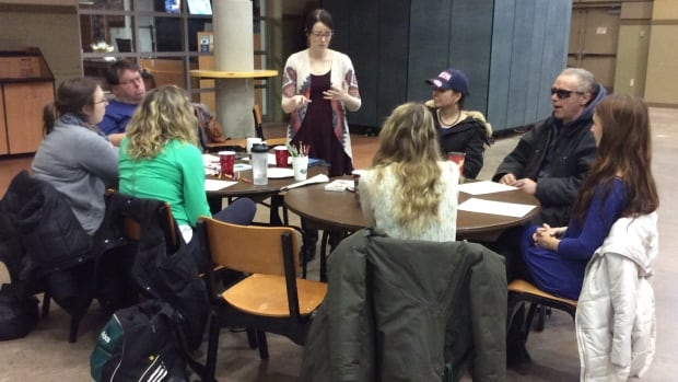 Katelynn Clow explains the second of three art activities planned for the two-hour class.