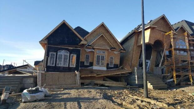 Environment Canada blames a downburst for damage to two partially constructed houses in Brampton.