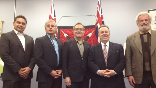 Aboriginal Affairs Minister David Zimmer, centre, poses for a photo with Wesley Bova, left, president of the Ontario First Nations Technical Services Corporation, MPPs Bill Mauro and Michael Gravelle, and professor David Pearson, right, of Laurentian University's School of the Environment.   Zimmer was in Thunder Bay to announce provincial funding for two initiatives to help First Nations deal with climate change.