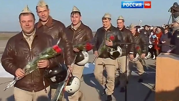 In Krasnodar Region, Russia, families greet the Russian troops returning from Syria. It's a hero's welcome, complete with flowers and medal awards right on the tarmac.
