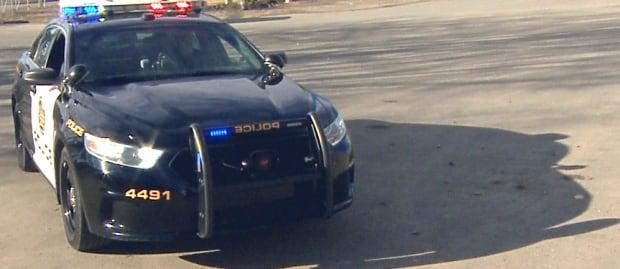 Calgary police new black and white car