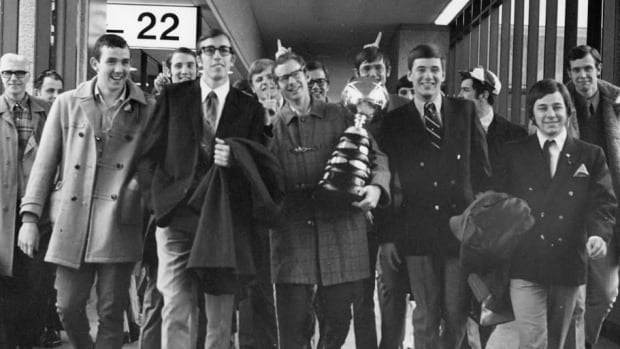 The victorious 1972 UBC men's basketball team celebrates with the W. P. McGee Trophy after winning the CIS championship.