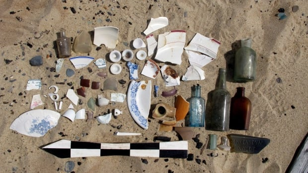 Various artifacts from the settlement of Sable Island, NS, sit in the sand as they were catalogued for a survey in this undated Parks Canada handout photo.