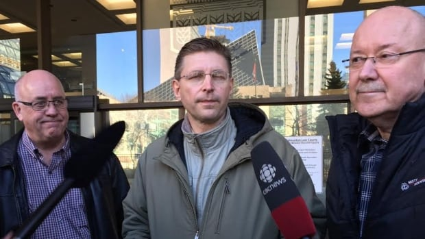 An Edmonton judge extended an injunction against the removal of Thorhild councillors Larry Sisson (left), Reeve Dan Buryn (centre), Wayne Crosswell Friday.