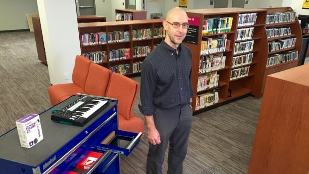 Rob Henderson shows off some of the new equipment at the McConachie branch.