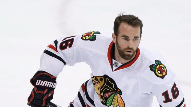 Chicago Blackhawks' Andrew Ladd (16) makes his return to Winnipeg after being traded to the Chicago Blackhawks by the Winnipeg Jets on Friday, March 18, 2016.