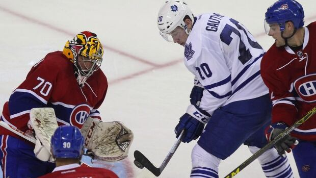 Toronto Maple Leafs' Frederik Gauthier, shown at centre in this file photo,  is expected to make his NHL debut against the Buffalo Sabres on Saturday night.