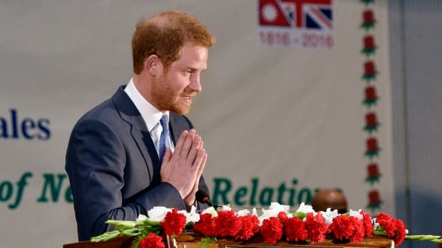 Prince Harry greets guests with a traditional 'Namaste' during a welcoming reception at a hotel in Kathmandu on the first day of his visit to Nepal on Saturday.