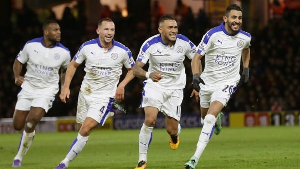 Leicester's Riyad Mahrez, right, scored his 16th goal of the season as his team maintained their lead in the bid for their first-ever league title.