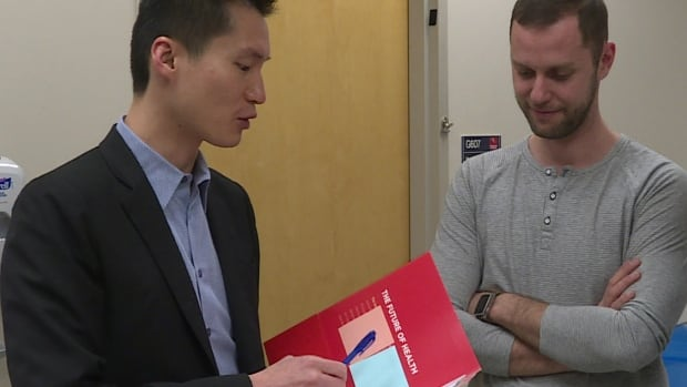 Dr. Daniel Heng, left, says new research in testicular cancer is good news for patients and survivors.