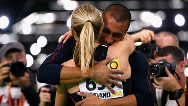 Brianne Theisen-Eaton of Canada is congratulated by her husband Ashton Eaton of the United States on winning the gold medal after the women's pentathlon on Thursday. Friday the duo became the first husband and wife pair to each win gold in the multi-events at a world championship.