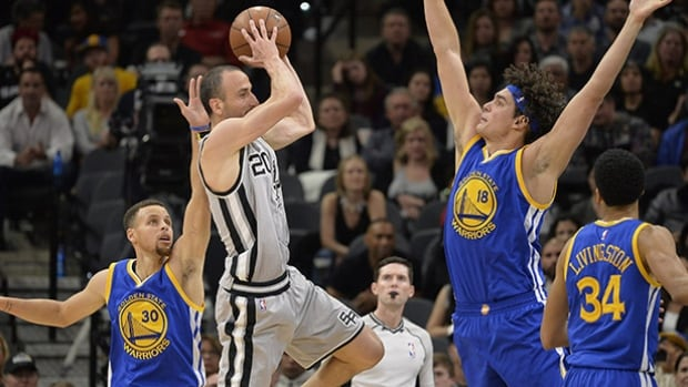 san Antonio Spurs guard Manu Ginobili looks to pass around Golden State Warriors centre Anderson Varejao during the first half on Saturday in San Antonio.