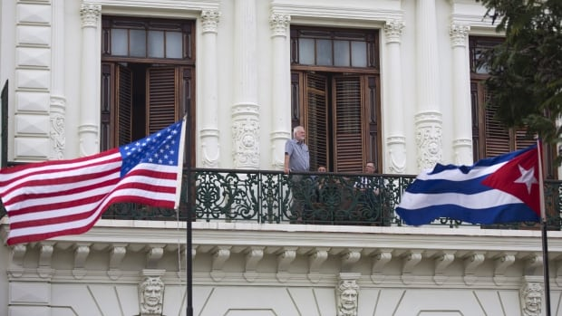 Tourists look out from a balcony at a hotel in Havana, Cuba in November 2015. Starwood Hotels and Resorts announced Saturday that it had signed a deal to renovate and run three Cuban hotels. U.S. hotel chains have not operated in Cuba for more than 50 years.